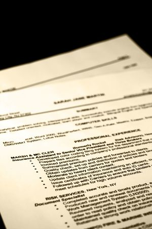 A fictitious resume tinted with a black background Stock Photo