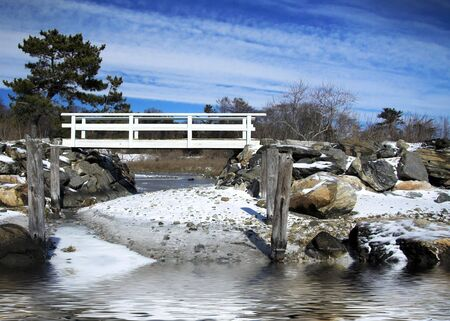 Scenic landscape with bridge crossing stream by ocean Stock Photo - 2515678
