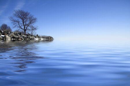 Frozen beach reflection with a vivid blue sky Stock Photo - 2515663