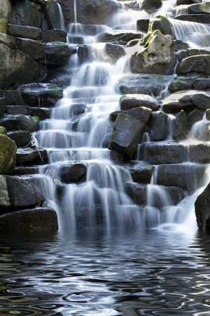 cascading: Scenic waterfall with white water cascading over rocks