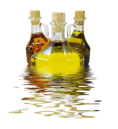 balsamic: Three olive oil bottles isolated against a white background Stock Photo