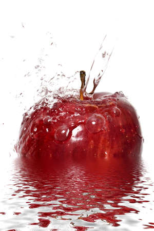 Water splashing down on an apple with reflection Stock Photo - 2538911