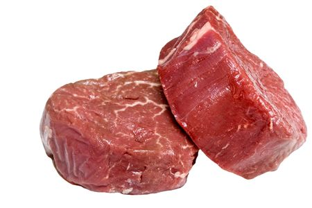 Two raw filet steaks isolated on white