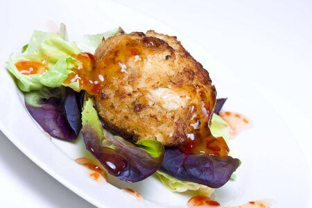 edible fish: Fresh crab cake salad with sweet chili sauce
