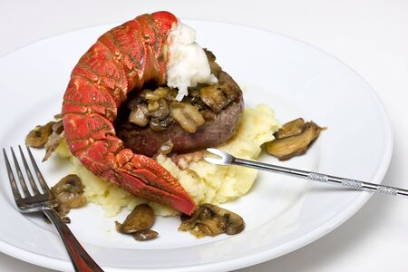 Lobster tail and filet steak meal photo