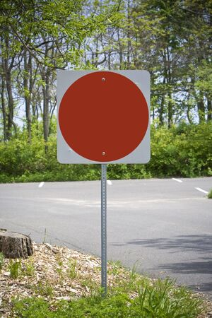 Blank red stop sign in carpark Stock Photo