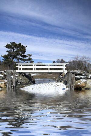 Scenic bridge over a partially frozen river at the beach Stock Photo - 2689850