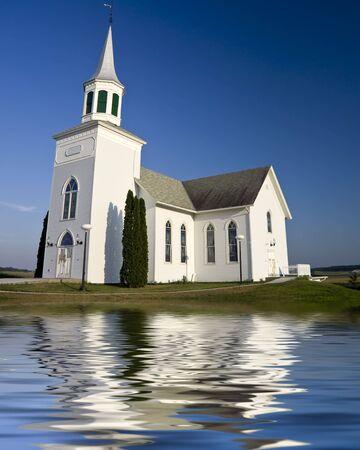 Old white church set against a dark blue sky Stock Photo - 2689845