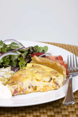 Quiche Lorraine with fresh salad on a white plate Stock Photo - 2908135