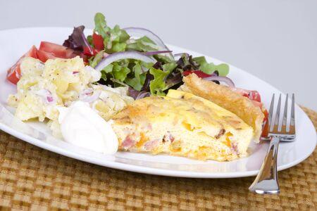 epicurean: Quiche Lorraine with fresh salad on a white plate