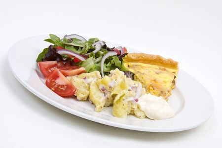 Quiche Lorraine with fresh salad on a white plate Stock Photo - 2908119