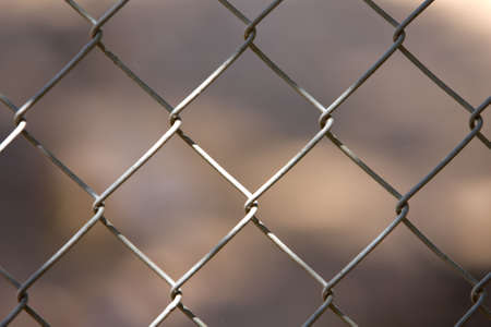 wire fence: Chainlink fence macro in sunlight Stock Photo
