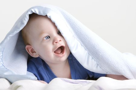 toothy: Beautiful redheaded twin baby under blanket