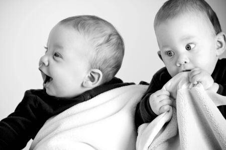Adorable twin boys with blankets Stock Photo - 3124401