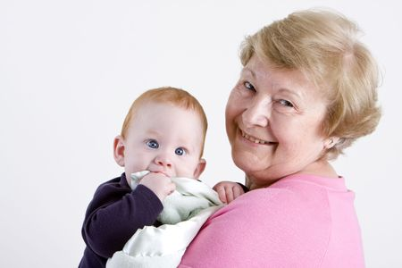 Proud grandmother holding red headed grandson photo