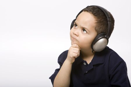 Boy listening to music with headphones on white background Stock Photo - 3128557
