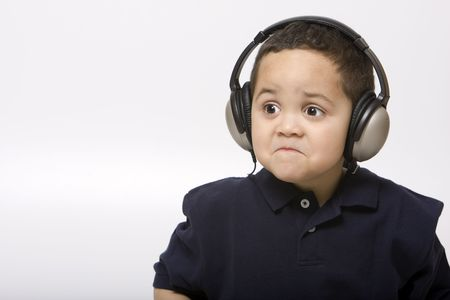 Sad boy with headphones not liking song choice Stock Photo - 3124380