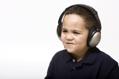 Sad boy with headphones not liking song choice photo