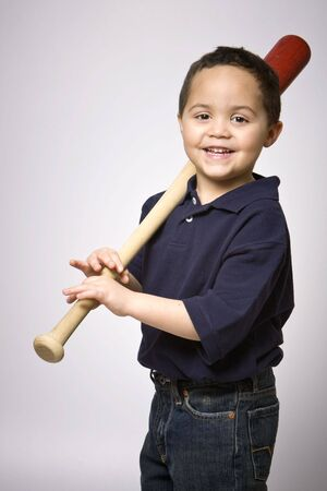 Young hispanic boy with baseball bat photo
