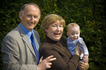 Grandparents with their grandson portrait in garden Stock Photo - 3124449