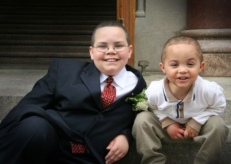 Two boys at a formal ceremony outside a church