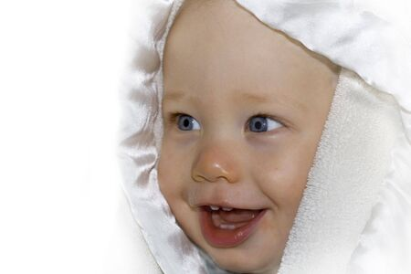 Baby smiling with bath towel over head