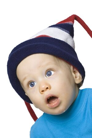 Surprised expression on baby boy in winter hat Stock fotó