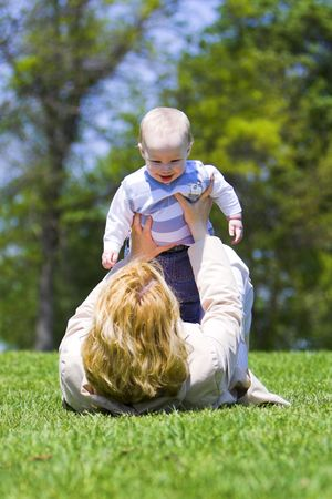 hapiness: Mother and son playing in the summer sunshine