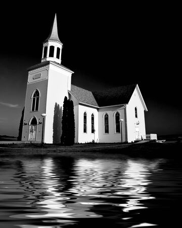 Old white church set against a dark stormy sky Stock Photo - 3145471