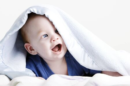Beautiful redheaded twin baby under blanket in high contrast color