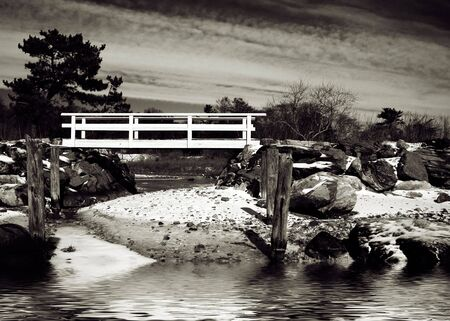 Scenic landscape with bridge crossing stream by ocean Stock Photo - 3185104