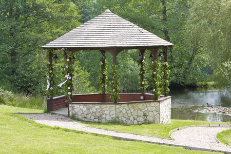 sone: Sone  gazebo decorated with flowers and ribbons Stock Photo