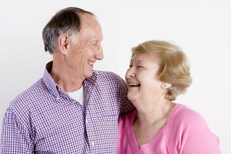Happy embracing senior couple portrait