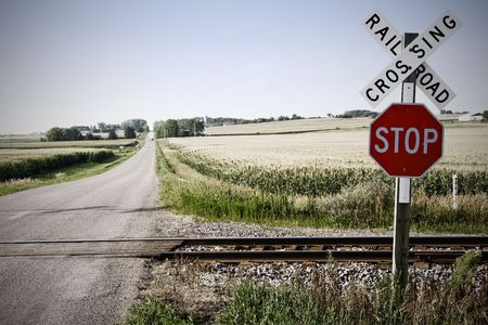 Stop sign on railroad crossing in American mid-west