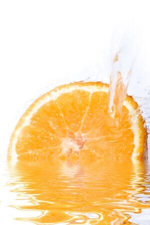 Water splashing on a fresh cut orange Imagens