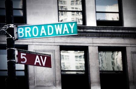 manhattan mirror new york: Broadway sign in New York City with grungy high contrast coloring