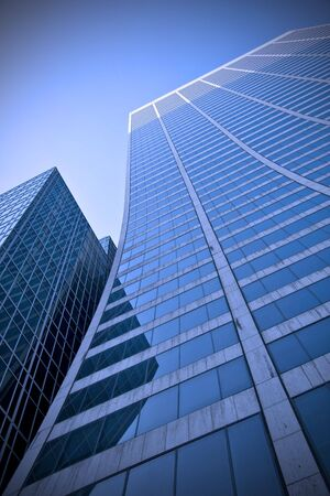 Looking up a curved skyscraper office block in New York City Stock Photo - 3399956