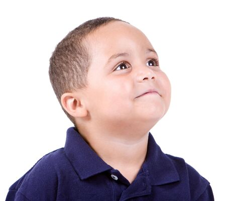 Happy mixed race boy looking up on white background Stock Photo - 3421650