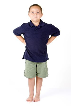 Happy mixed race boy with hands on hips on white background Stock Photo - 3421646