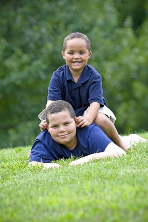 Two brothers playing on fresh green grass Stock Photo - 3421748