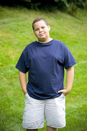 obese child: Happy latino boy close-up portrait outdoors