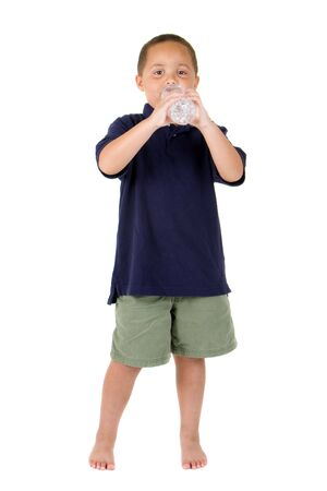 Happy latino boy drinking from water bottle on white background Stock Photo - 3693848