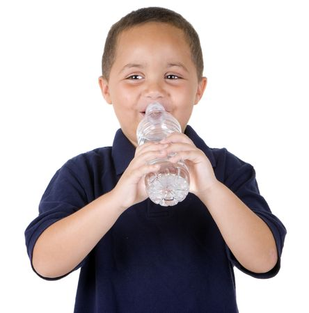 Happy latino boy drinking from water bottle on white background Stock Photo - 3693856