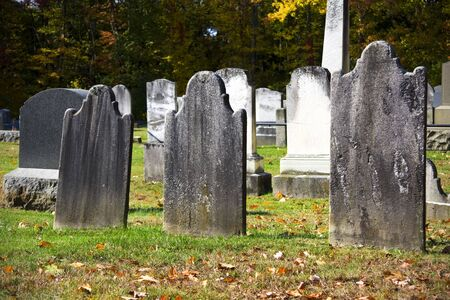 christian halloween: Old granite blank headstones in creepy churchyard during autumn season