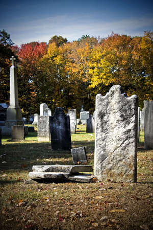 Old creepy churchyard during autumn seasonin high contrast color Stock Photo - 3760113