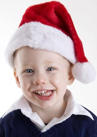 drool: Handsome young child wearing a red santa claus hat Stock Photo