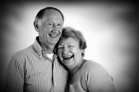 dependence: Happy embracing senior couple portrait black and white Stock Photo