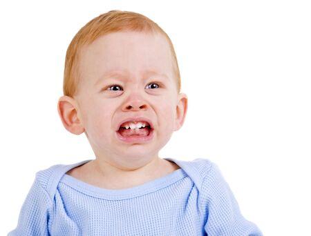 teething: Sad baby boy crying with teething pain