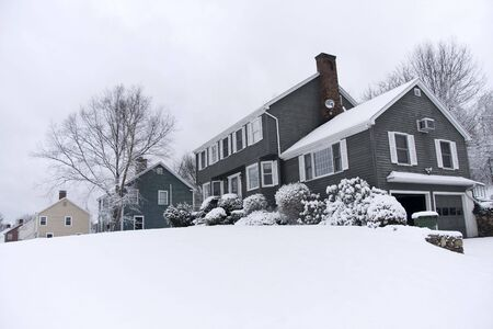 row house: Traditional American colonial style house in winter Stock Photo