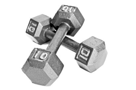heavy weight: Two ten pound dumbbells isolated on white